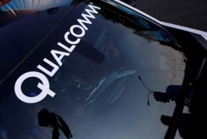 A logo of U.S. chipmaker Qualcomm is seen on the windshield of a car in Beijing